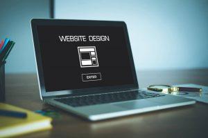 Computer with website design written on screen